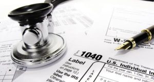 taxes-blog-stethoscope-on-tax-forms